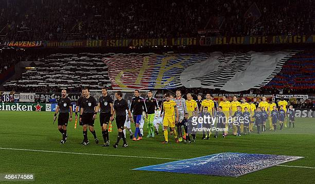 Steven Gerrard of Liverpool leads the team out before the UEFA Champions League match between FC Basel 1893 and Liverpool FC on October 1 2014 in...