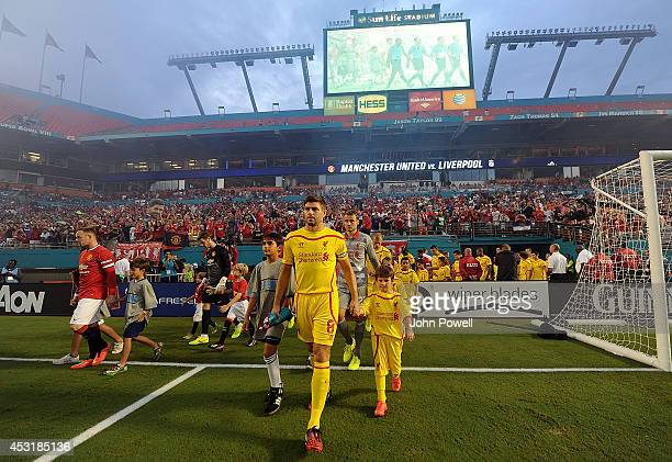 Steven Gerrard of Liverpool leads the teams out during the International Champions Cup 2014 final match between Liverpool FC and Manchester United at...