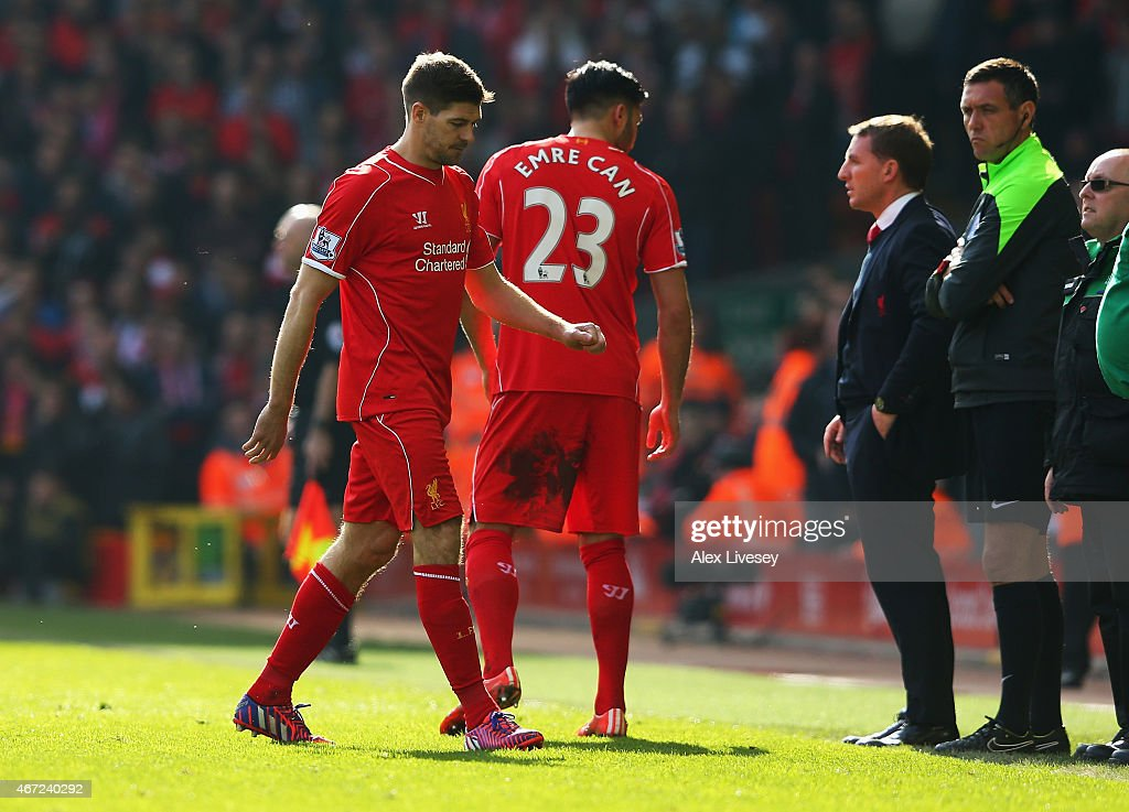 Steven Gerrard of Liverpool leaves the field after being sent off as Brendan Rodgers, manager of Liverpool looks on during the Barclays Premier League match between Liverpool and Manchester United at Anfield on March 22, 2015 in Liverpool, England.