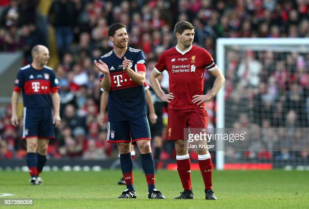Steven Gerrard of Liverpool Legends and Xabi Alonso of Bayern Munich Legends look on during the friendly match between Liverpool FC Legends and FC...