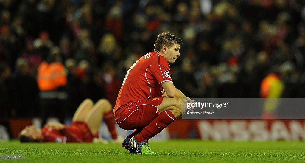 Steven Gerrard of Liverpool looks dejected at the end of the UEFA Champions League match between Liverpool FC and FC Basel 1893 on December 9, 2014 in Liverpool, United Kingdom.