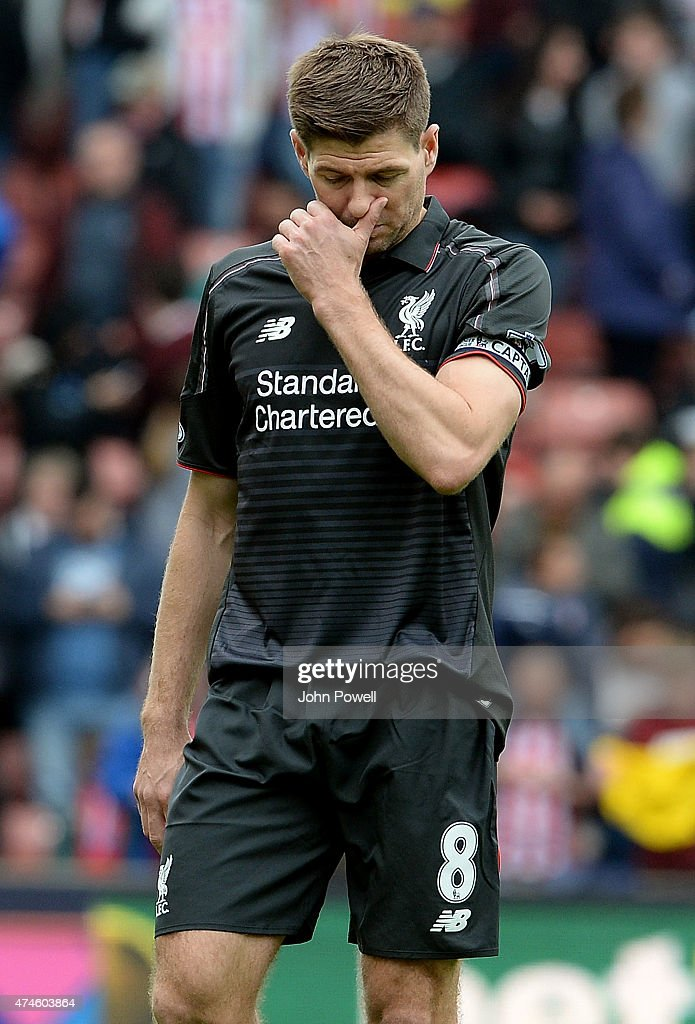 Steven Gerrard of Liverpool looks dejected during the Barclays Premier League match between Stoke City and Liverpool at the Britannia Stadium on May 24, 2015 in Stoke on Trent, England.