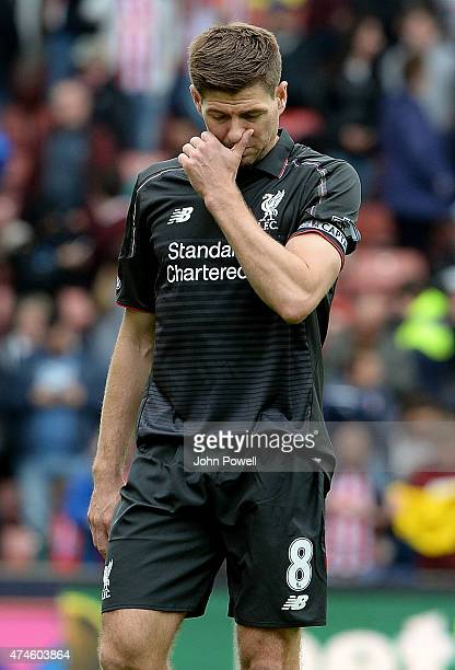 Steven Gerrard of Liverpool looks dejected during the Barclays Premier League match between Stoke City and Liverpool at the Britannia Stadium on May...