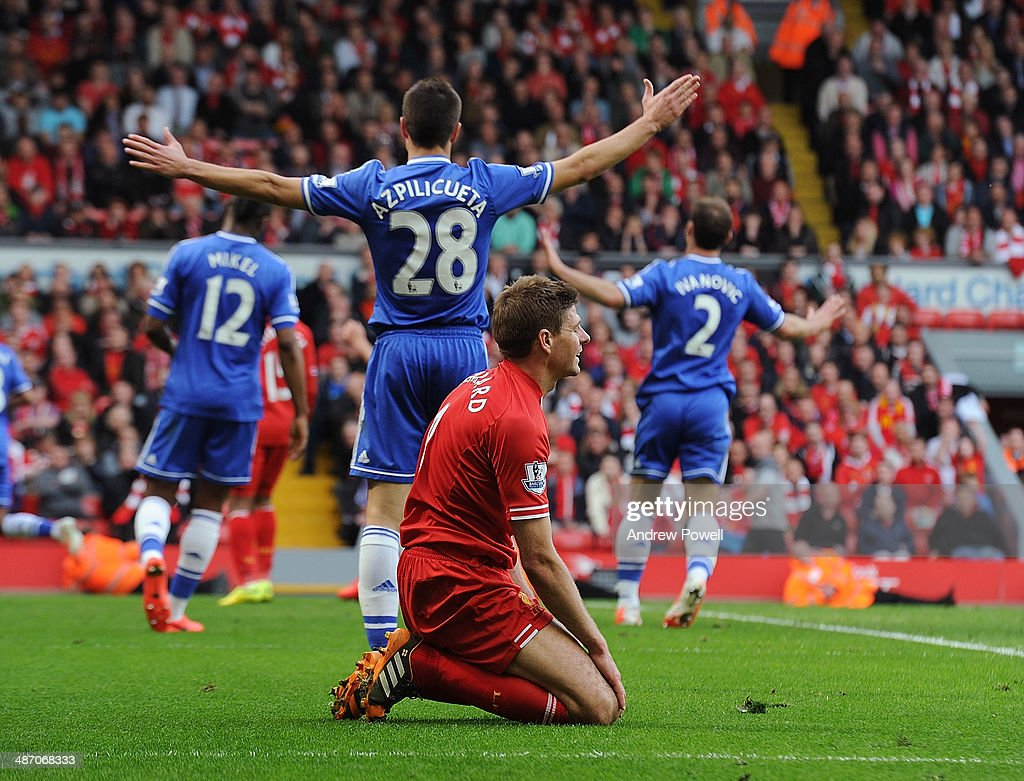 Steven Gerrard of Liverpool looks dejected during the Barclays Premier League match between Liverpool and Chelsea at Anfield on April 27, 2014 in Liverpool, England.