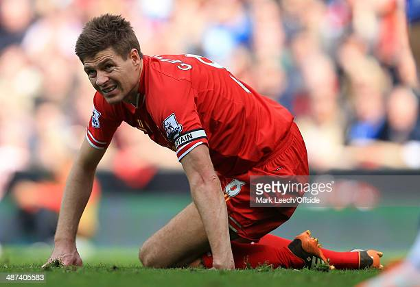 Steven Gerrard of Liverpool looks dejected during the Barclays Premier League match between Liverpool and Chelsea at Anfield on April 27, 2014 in...