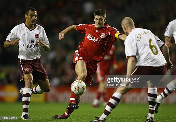 Steven Gerrard of Liverpool looks for a way past Philippe Senderos of Arsenal during the UEFA Champions League Quarter Final second leg match between...