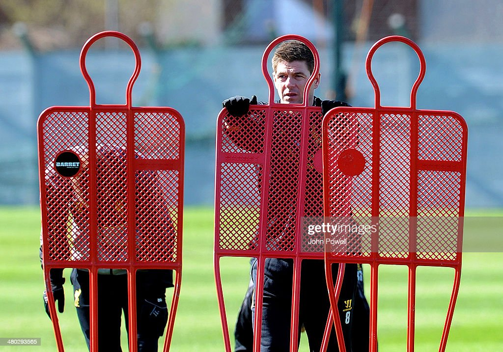 Steven Gerrard of Liverpool looks on during a training session at Melwood Training Ground on March 24, 2014 in Liverpool, England.