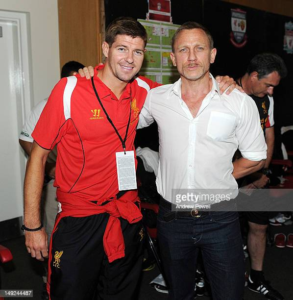 Steven Gerrard of Liverpool meets Daniel Craig during the preseason tour friendly between Liverpool and Roma on July 25 2012 in Boston Massachusetts