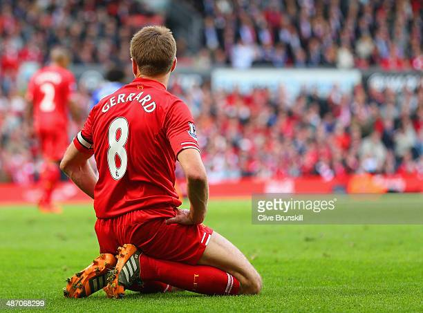 Steven Gerrard of Liverpool on his knees during the Barclays Premier League match between Liverpool and Chelsea at Anfield on April 27, 2014 in...