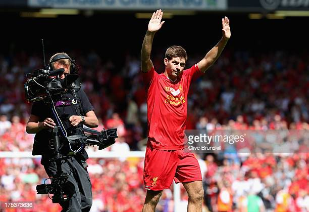 Steven Gerrard of Liverpool on his lap of honour for the fans at the Kop end after the Steven Gerrard Testimonial Match between Liverpool and...