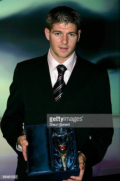 Steven Gerrard of Liverpool poses with his award for being selected as the UEFA Most Valuable Player prior to the UEFA Champions League Group Stage...