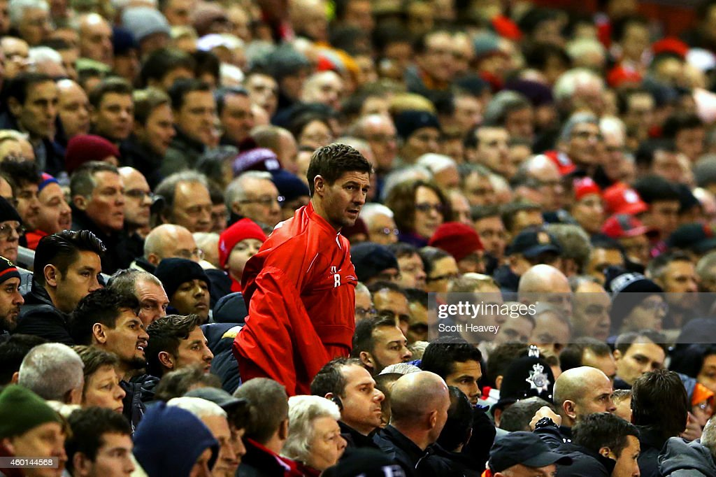 Steven Gerrard of Liverpool prepares to come on to the field during the Barclays Premier League match between Liverpool and Sunderland at Anfield on December 6, 2014 in Liverpool, England.