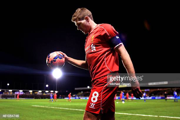 Steven Gerrard of Liverpool prepares to take a corner during the FA Cup Third Round match between AFC Wimbledon and Liverpool at The Cherry Red...