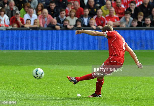 Steven Gerrard of Liverpool scores from a free kick during the Barclays Premier League match between Liverpool and Everton at Anfield on September 27...