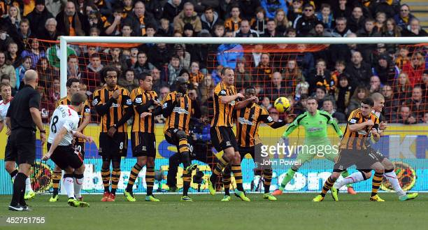 Steven Gerrard of Liverpool scores from a freekick during the Barclays Premier League match between Hull City and Liverpool at the KC Stadium on...