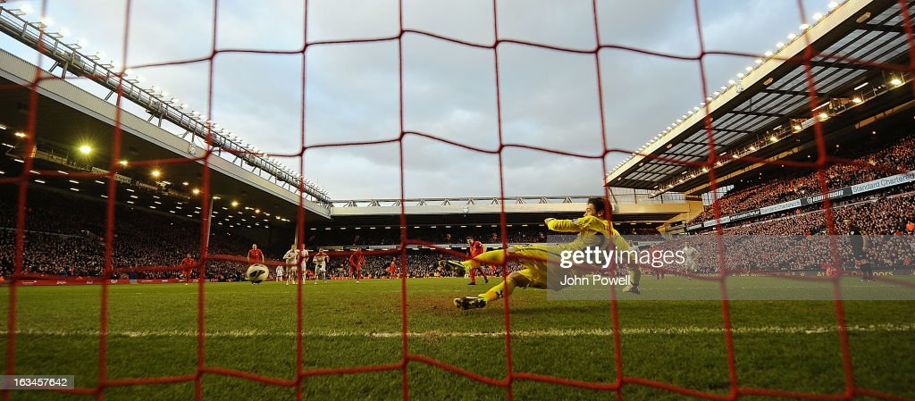 Steven Gerrard of Liverpool scores from the penalty spot during the Barclays Premier League match between Liverpool and Tottenham Hotspur at Anfield on March 10, 2013 in Liverpool, England.