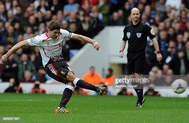 Steven Gerrard of Liverpool scores from the penalty spot for the second time during the Barclays Premier League match between West Ham United and...