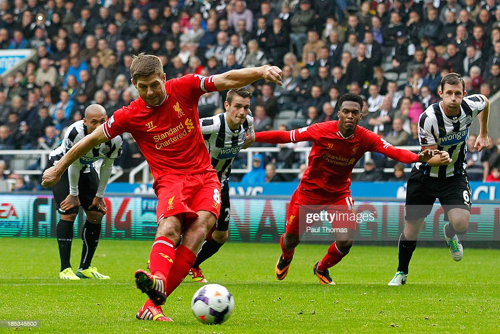 Steven Gerrard of Liverpool scores his 100th goal and Liverpool's first from the penalty spot during the Barclays Premier League match between Newcastle United and Liverpool at St James' Park on October 19, 2013 in Newcastle-Upon-Tyne, England.