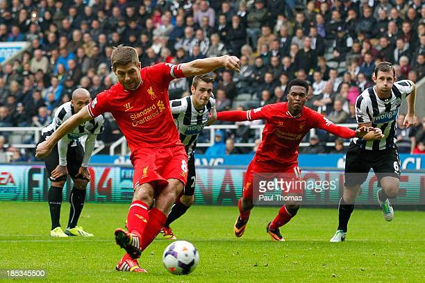 Steven Gerrard of Liverpool scores his 100th goal and Liverpool's first from the penalty spot during the Barclays Premier League match between...