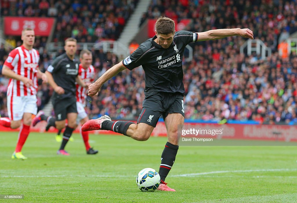 Steven Gerrard of Liverpool scores his team's first goal during the Barclays Premier League match between Stoke City and Liverpool at Britannia Stadium on May 24, 2015 in Stoke on Trent, England.