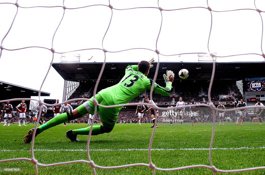 Steven Gerrard of Liverpool scores his team's second and matchwinning goal from the penalty spot past goalkeeper Adrian of West Ham during the Barclays Premier League match between West Ham United and Liverpool at Boleyn Ground on April 6, 2014 in London, England.