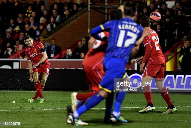 Steven Gerrard of Liverpool scores his team's second goal from a free kick during the FA Cup Third Round match between AFC Wimbledon and Liverpool at...