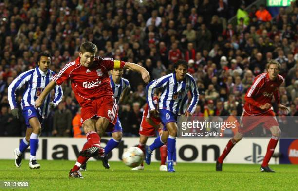 Steven Gerrard of Liverpool scores his team's third goal from the penalty spot during the UEFA Champions League Group A match between Liverpool and...
