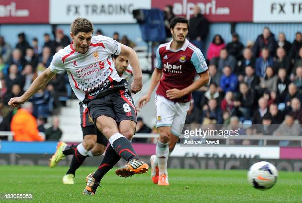 Steven Gerrard of Liverpool scores the opening goal during the Barclays Premier League match between West Ham United and Liverpool at Boleyn Ground...