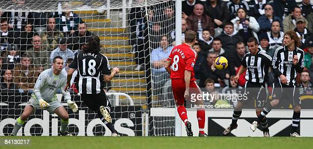 Steven Gerrard of Liverpool scores the opening goal during the Barclays Premier League match between Newcastle United and Liverpool at St James Park...