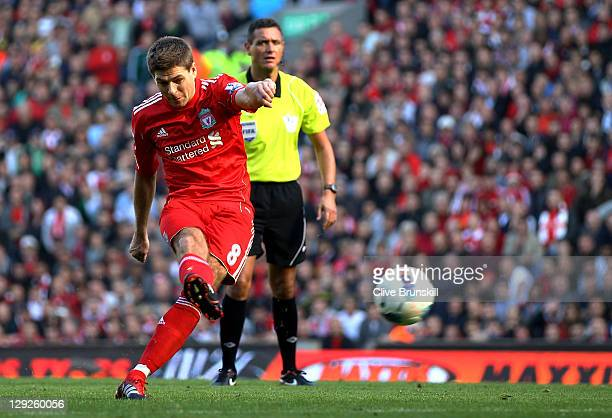 Steven Gerrard of Liverpool scores the opening goal from a free kick during the Barclays Premier League match between Liverpool and Manchester United...