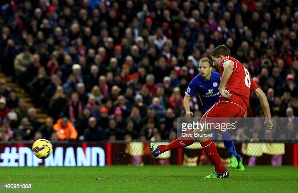 Steven Gerrard of Liverpool scores the opening goal from the penalty spot during the Barclays Premier League match between Liverpool and Leicester...