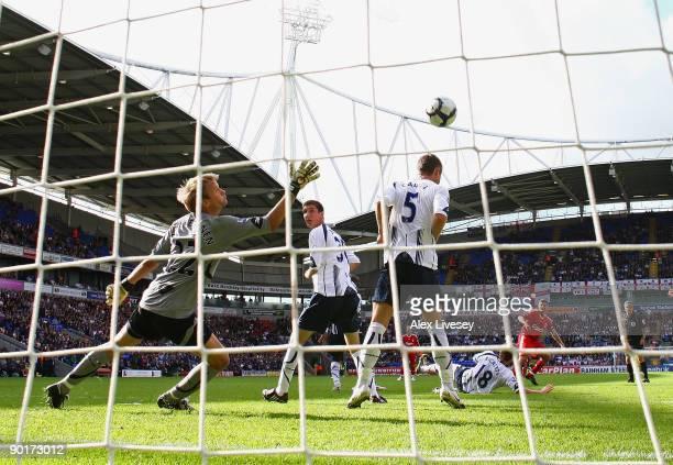 Steven Gerrard of Liverpool scores the winning goal past Jussi Jaaskelainen of Bolton Wanderers during the Barclays Premier League match between...