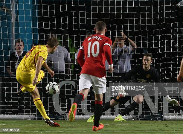 Steven Gerrard of Liverpool scores their first goal during the preseason friendly match between Manchester United and Liverpool at Sun Life Stadium...
