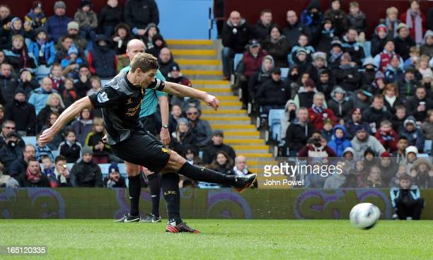 Steven Gerrard of Liverpool scores their second from the penalty spot during the Barclays Premier League match between Aston Villa and Liverpool at...