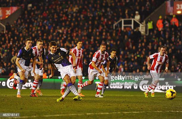 Steven Gerrard of Liverpool scores their third goal from the penalty spot during the Barclays Premier League match between Stoke City and Liverpool...