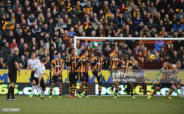Steven Gerrard of Liverpool scores with a free kick during the Barclays Premier League match between Hull City and Liverpool at KC Stadium on...