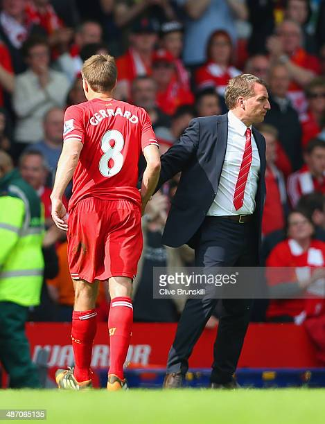 Steven Gerrard of Liverpool shakes hands with Manager Brendan Rodgers of Liverpool at the end of the match during the Barclays Premier League match...