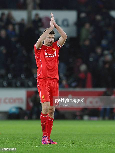 Steven Gerrard of Liverpool shows his appreciation to the fans at the end of the Barclays Premier League match between Swansea City and Liverpool at...