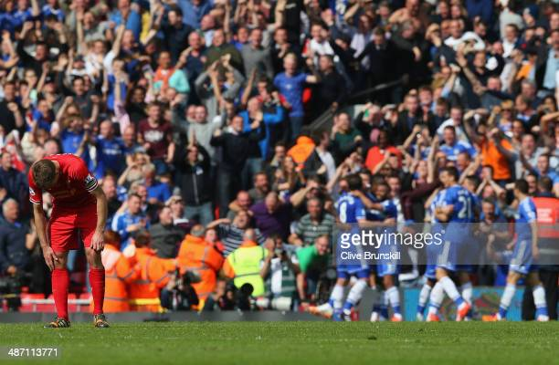 Steven Gerrard of Liverpool shows his dejection as Chelsea players celebrate their second goal scored by Willian during the Barclays Premier League...