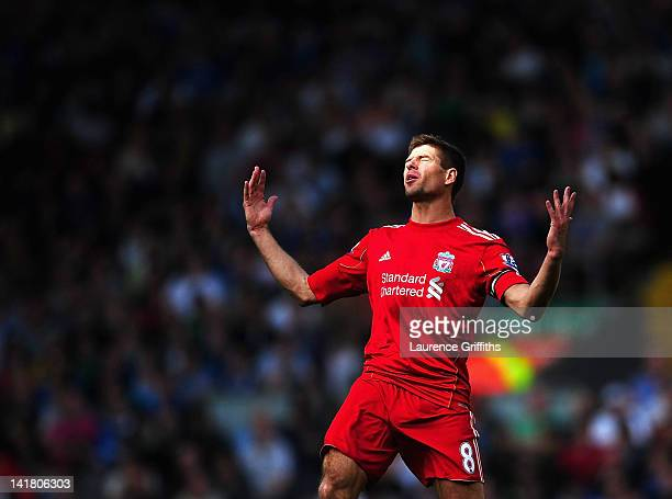 Steven Gerrard of Liverpool shows his frustrations during the Barclays Premier League match between Liverpool and Wigan Athletic at Anfield on March...