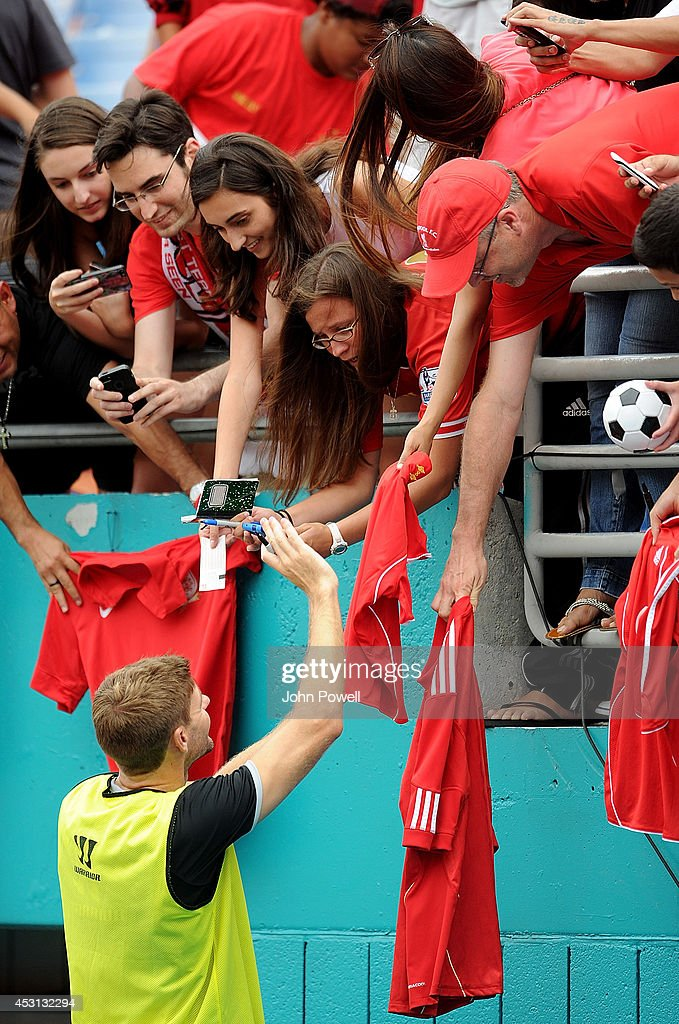Steven Gerrard of Liverpool signs autographs after an open training session at Sunlife Stadium on August 3, 2014 in Miami, Florida.