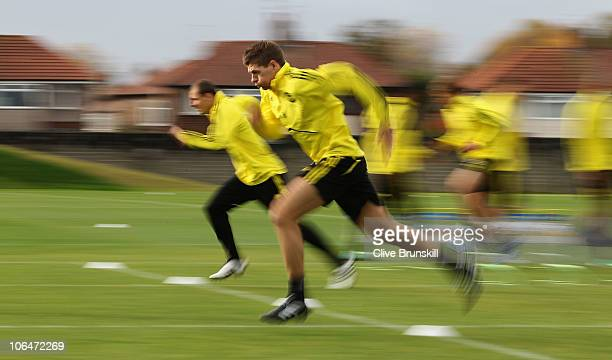 Steven Gerrard of Liverpool sprints during a training session ahead of their UEFA Europa League match against SSC Napoli at Melwood Training Ground...