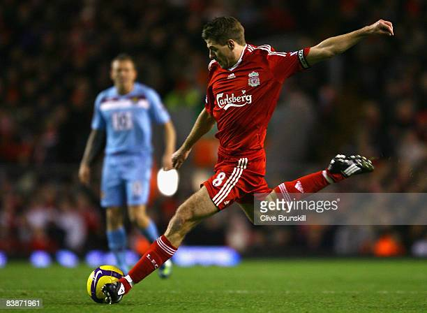 Steven Gerrard of Liverpool takes a free kick during the Barclays Premier League match between Liverpool and West Ham United at Anfield on December 1...