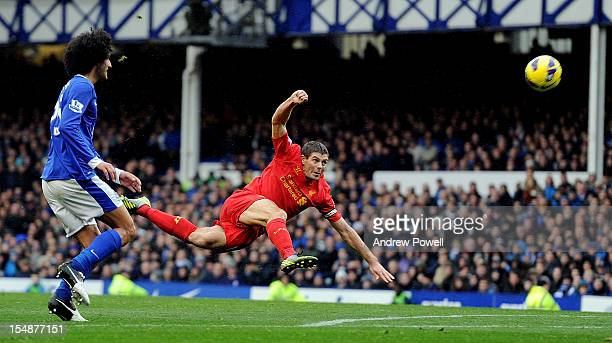 Steven Gerrard of Liverpool takes a shot on goal during the Barclays Premier League match between Everton and Liverpool at Goodison Park on October...