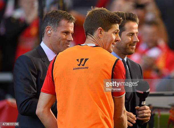 Steven Gerrard of Liverpool talks to former Liverpool players Jamie Carragher and Jamie Reknappahead of the Barclays Premier League match between...