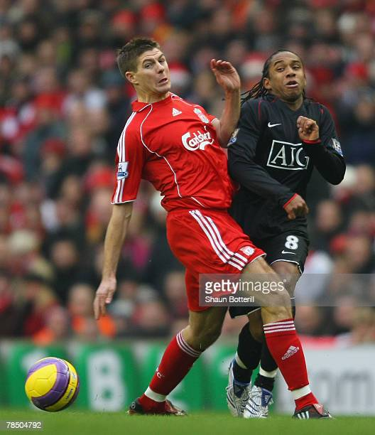 Steven Gerrard of Liverpool tangles with Anderson of Manchester United during the Barclays Premier League match between Liverpool and Manchester...