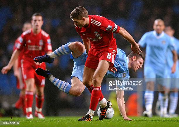 Steven Gerrard of Liverpool tangles with James Milner of Manchester City during the Carling Cup Semi Final First Leg match between Manchester City...