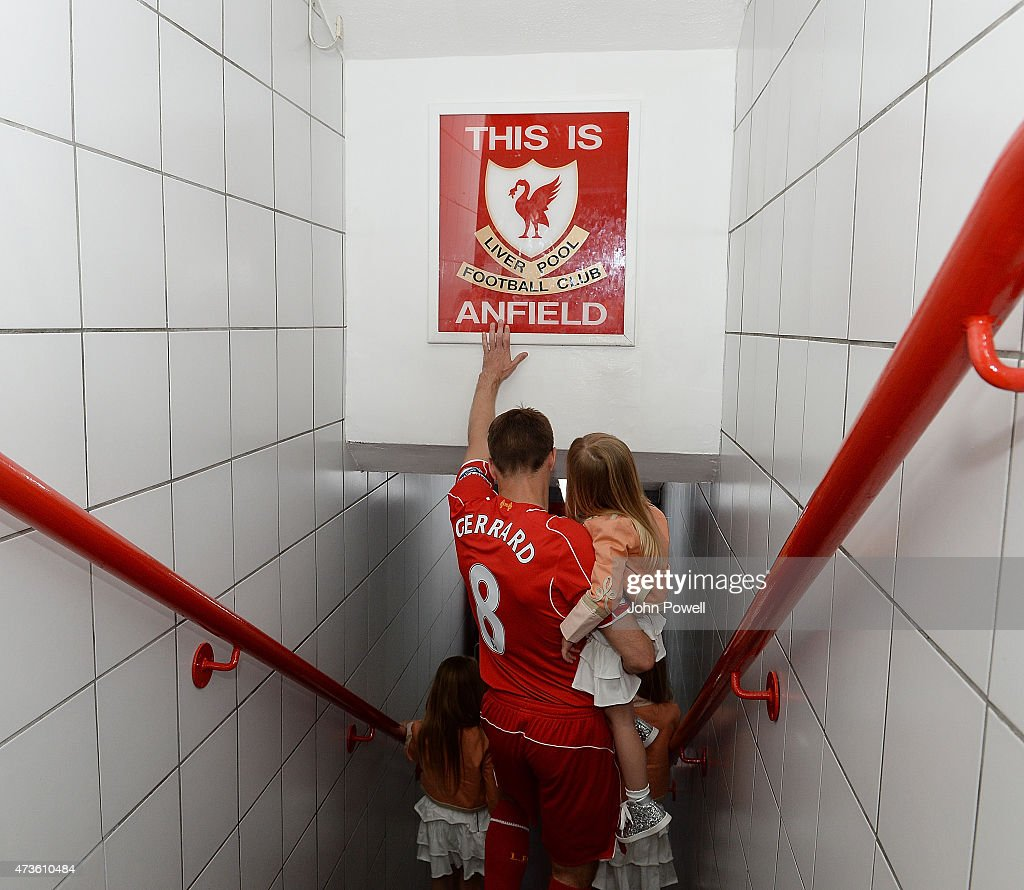 Steven Gerrard of Liverpool touches the famous sign before the Barclays Premier League match between Liverpool and Crystal Palace at Anfield on May 16, 2015 in Liverpool, England.