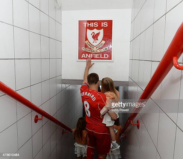 Steven Gerrard of Liverpool touches the famous sign before the Barclays Premier League match between Liverpool and Crystal Palace at Anfield on May...