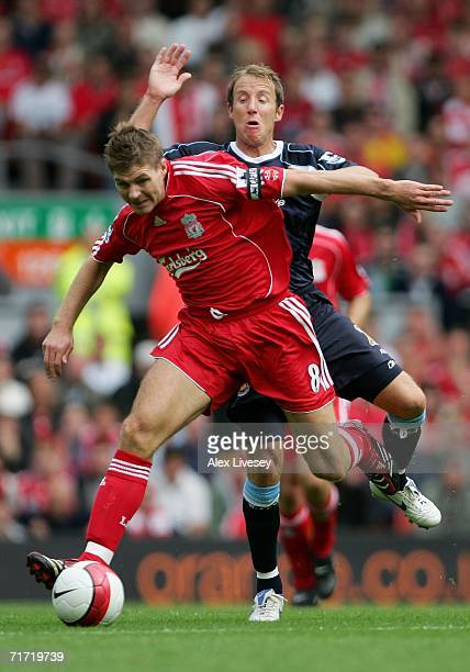 Steven Gerrard of Liverpool tussles for posession with Lee Bowyer of West Ham United during the Barclays Premiership match between Liverpool and West...